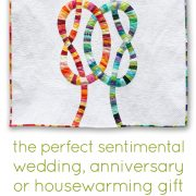 Double Wedding Knots is perfect for a wedding, anniversary or housewarming gift! Give a one-of-a-kind, personal piece of art gthat they will treasure forever and pass down to future generations. Quilt has a durable sleeve sewn on the back making it ready to hang on a wall. Double Wedding Knots was originally created to commemorate the wedding union of two close friends. Not only does it celebrate a special day, but it is also a reminder of a life full of happiness and friendship. This modern, original design is a striking alternative to a traditional double wedding ring design. This quilt design was showcased at the QuiltCon 2018 juried exhibition. Want to customize this design? We can make you a double wedding knot quilt or pillow for you in any size and color palette.