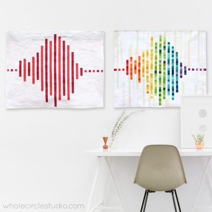 "Modern Love Quilt. Inspired by frequency waves, Modern Love is an abstract interpretation of what the word ""love"" might sound like. This tested pattern contains both detailed instructions and diagrams, making it easy to piece. Instructions are provided for three sizes: Wall, Throw and Queen. Included in this pattern are row locations for all of the fabric pieces so additional colors and/or prints can be added. Designed by Whole Circle Studio."