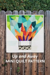 Make a Up and Away mini for your next quilt swap or as a gift. This 18″ x 18″ foundation paper pieced quilt is great as a wallhanging — add a border to make an oversized pillow or make multiple blocks and construct a larger quilt! This is the perfect pattern to use up your fabric scraps! If you need additional fabric to complement your stash, charm packs and fat eighths work well with this pattern. This tested pattern contains both detailed instructions and diagrams, making it easy to piece.
