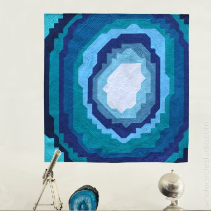 Stone Slice—a beginner friendly, easy quilt. Make it for a kid's room, budding geologist or rock / geode enthusiast! Instructions for 3 sizes: wall, quilt or queen quilt. Easy to assemble with fabric stripes and half square triangles (HSTs). Lots of diagrams and tips in the pattern!