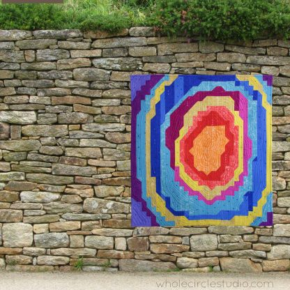 Geode and rock lovers will adore this nature-inspired quilt entitled Stone Slice. Easy to follow, beginner friendly instructions are included for 3 sizes: wall, throw and queen. This modern quilt is constructed from strips and half square triangles (HSTs). Download this PDF pattern and get started today! Sample show is made with Alison Glass Sun Print fabric by Andover.