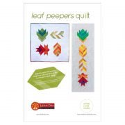 A fun, modern autumn wall hanging quilt or table runner! Leaf Peepers is a modern spin on the traditional half square triangle block. Join the sew along and quilt along and make this for your home or as a gift for Thanksgiving! Leah Day and Whole Circle Studio will walk you through all of the steps of this PDF pattern on their blogs.