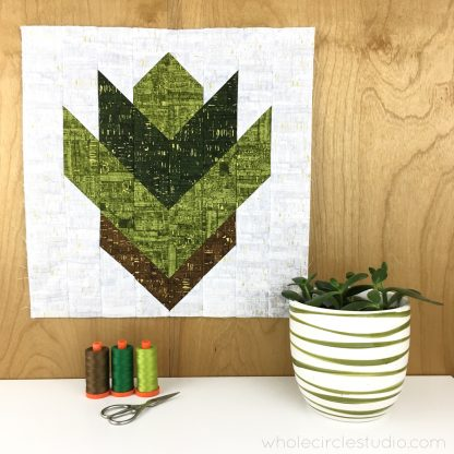 Leaf Peepers Quilt Pattern: Block 1. A modern, graphic spin on the traditional half square triangle. A great PDF pattern to use with solid fabric, prints or batiks! Pattern available at wholecirclestudio.com
