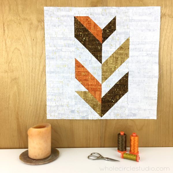 Leaf Peepers Quilt Pattern: Block 1. A modern, graphic spin on the traditional half square triangle. A great PDF pattern to use with solid fabric, prints or batiks!