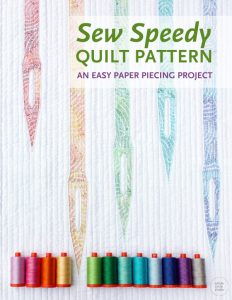 A great mini quilt to make as a wall hanging for your sewing space or gift to a sewist! Sew Speedy is a graphic modern quilt that uses foundation paper piecing techniques. Make additional blocks to make a larger quilt (layout ideas are provided). A pre-cut strip friendly pattern designed by Whole Circle Studio.