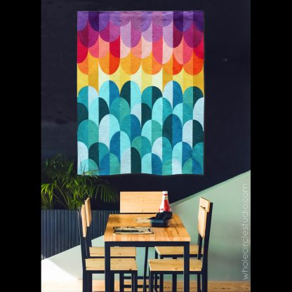 Big Island Sunset. A modern quilt designed and made by Sheri Cifaldi-Morrill of Whole Circle Studio. Inspiration for Big Island Sunset came from one of my most favorite places in the world—the Kona area of the Big Island of Hawaii. This modern interpretation of the spectacular sunsets on the west coast of Hawaii.