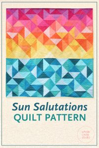 Make a beautiful sunrise quilt. This is a perfect gift for a yoga or beach lover. Good for beginner quilters, this modern spin on the traditional half-square triangle is easy to make. Pattern by Whole Circle Studio.
