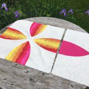 Picnic Petals blocks, a modern spin on the traditional Flowering Snowball quilt block.