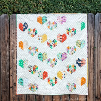 Fat Quarter bundle version of Love at First Sight — an easy, beginner-friendly foundation paper piecing quilt pattern and makes the perfect wedding, engagement, anniversary or friendship gift. It's also super sweet for a baby or kid. Included in the pattern are instructions for two types of heart blocks—basic and details along with fabric requirements and instructions to arrange the blocks into 3 layouts—a wall quilt or two types of throw quilts. Make it your own by swapping out fabric or rearranging the blocks.