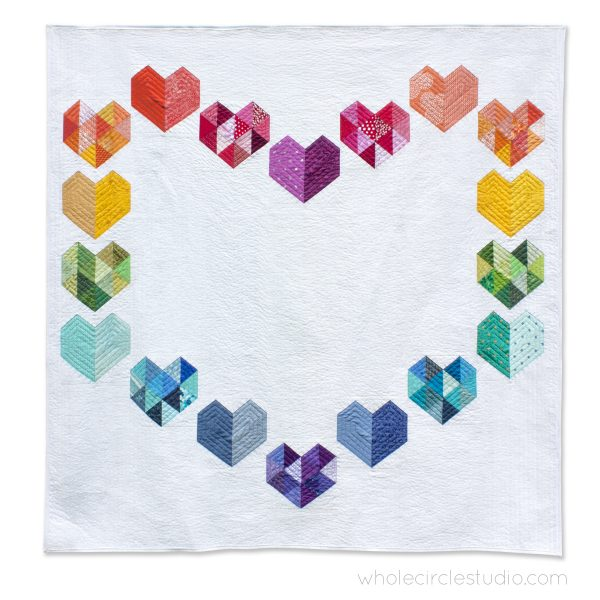 rainbow, scrap version of Love at First Sight — an easy, beginner-friendly foundation paper piecing quilt pattern and makes the perfect wedding, engagement, anniversary or friendship gift. It's also super sweet for a baby or kid. Included in the pattern are instructions for two types of heart blocks—basic and details along with fabric requirements and instructions to arrange the blocks into 3 layouts—a wall quilt or two types of throw quilts. Make it your own by swapping out fabric or rearranging the blocks.