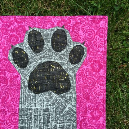 """detail of Paws Up! — a fun, adorable quilt that uses intermediate foundation paper piecing techniques. Layout instructions are provided to make a Mini, Throw, Twin or Queen quilt. This tested pattern contains both detailed instructions and diagrams, making it easy to piece. Each Paws Up! block consists of 2 paws/legs and measures 30"""" x 30"""" making it a flexible design to customize your own quilting project."""