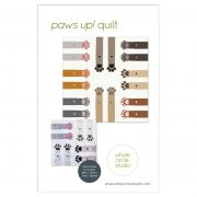 """Dog and cat lovers unite! This makes the perfect gift for anyone with a special furry pet in their life. Paws Up! is a fun, adorable quilt that uses intermediate foundation paper piecing techniques. Layout instructions are provided to make a Mini, Throw, Twin or Queen quilt. This tested pattern contains both detailed instructions and diagrams, making it easy to piece. Each Paws Up! block consists of 2 paws/legs and measures 30"""" x 30"""" making it a flexible design to customize your own quilting project."""