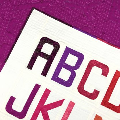 detail of Alphabet quilt made with Typecast Fast, a Foundation Paper Piecing (FPP) Pattern Make all 26 letters of the English alphabet, all the numbers and lots of punctuation — a total of 50 block designs! Pattern by Whole Circle Studio.