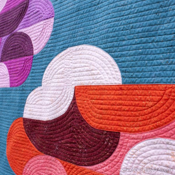 Dream big! Big Island Sky is the perfect gift to make for a baby, child, or nature lover. This quilt pattern is a bright, modern twist on the traditional Drunkard's Path block. Big Island Sunset is a fully tested pattern that contains detailed instructions and diagrams, making it a breeze to piece.