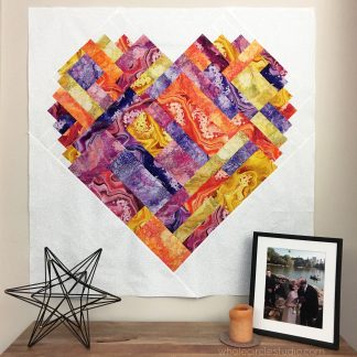 Pieces of Love is an easy, confident-beginner quilt pattern. Make the perfect wedding, engagement, anniversary or friendship gift. It's also super sweet for a baby or kid. Instructions in 3 sizes, including throw and queen. Fat Eight, Fat Quarter, and scrappy friendly! Available at wholecirclestudio.com