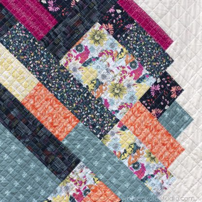detail of Pieces of Love is an easy, confident-beginner quilt pattern. Make the perfect wedding, engagement, anniversary or friendship gift. It's also super sweet for a baby or kid. Instructions in 3 sizes, including throw and queen. Fat Eight, Fat Quarter, and scrappy friendly! Available at wholecirclestudio.com